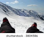Ski boots and slope - stock photo