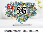5g concept with smartphone on... | Shutterstock . vector #380488825