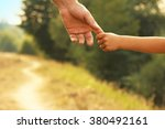 the parent holds the hand of a... | Shutterstock . vector #380492161