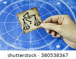 hand holding a card with sign...   Shutterstock . vector #380538367