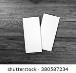 blank flyer over wooden... | Shutterstock . vector #380587234