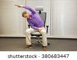 man exercising on chair in... | Shutterstock . vector #380683447