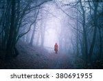 Alone Woman In Dark Forest