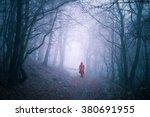 Alone Woman In Dark Forest