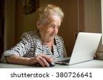 Elderly Woman Working On Lapto...