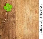 A Clover On Wooden Desk