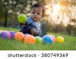 cute asian baby playing...   Shutterstock . vector #380749369