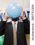 businessman blowing up a balloon | Shutterstock . vector #380751304