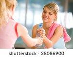 Generous Girl Giving Bottle Of...