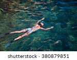 young woman snorkeling in... | Shutterstock . vector #380879851