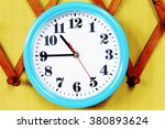 wall clock on the wood... | Shutterstock . vector #380893624