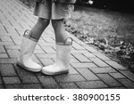 Little Girl In Rubber Boots ...