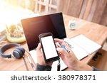 businessman holding a smart... | Shutterstock . vector #380978371
