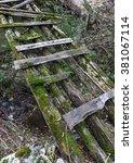old ruined wooden foot bridge... | Shutterstock . vector #381067114
