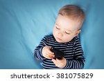 Little Boy On Blue Blanket...