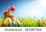 easter eggs and tulip on meadow | Shutterstock . vector #381087304