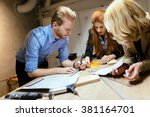 group of designers working on a ... | Shutterstock . vector #381164701