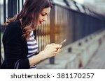 beautiful young woman looking... | Shutterstock . vector #381170257