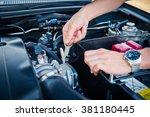 auto mechanic checking detail... | Shutterstock . vector #381180445