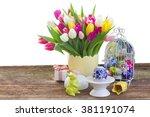 spring tulips with easter egg... | Shutterstock . vector #381191074
