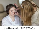 young beautiful bride applying... | Shutterstock . vector #381196645