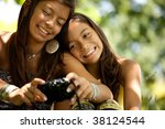 Two Young Sisters Making A...