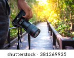 photographer holding his camera. | Shutterstock . vector #381269935