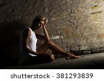 lonely young woman sitting on... | Shutterstock . vector #381293839