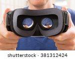 Stock photo man using virtual reality headset at home 381312424