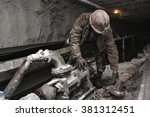 miner in a mine | Shutterstock . vector #381312451