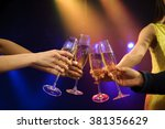people with champagne in a bar... | Shutterstock . vector #381356629