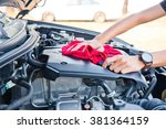 wipe cleaning the car engine... | Shutterstock . vector #381364159