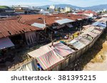 poor houses with sheet tin by... | Shutterstock . vector #381395215