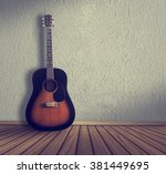 acoustic guitar in the room... | Shutterstock . vector #381449695