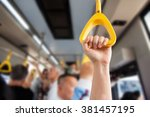 people hand holding handle on...   Shutterstock . vector #381457195