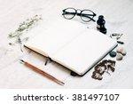 open notebook diary on wooden... | Shutterstock . vector #381497107