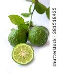 fresh green kaffir lime and cut ... | Shutterstock . vector #381518425