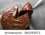 chocolate cake with a cut piece ... | Shutterstock . vector #381593071