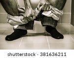 man sitting on toilet  diarrhea | Shutterstock . vector #381636211