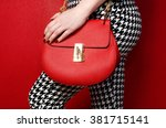 trendy woman in pants with red... | Shutterstock . vector #381715141