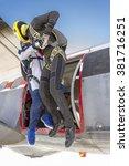 three parachutists jumping out... | Shutterstock . vector #381716251