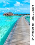 tropical beach in maldives with ... | Shutterstock . vector #381725095