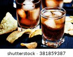 cold cola with ice in glasses... | Shutterstock . vector #381859387