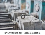 Small photo of Electric actuator for industrial mill in workshop. Tilt shift effect. Close up.