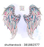 patterned wings on the grunge...   Shutterstock .eps vector #381882577