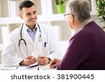 doctor consulting old patient... | Shutterstock . vector #381900445