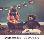 A Little Child Photographer Is...