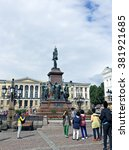 Small photo of HELSINKI, FINLAND - JULY 7, 2015: Many tourists and tour buses around the monument to Russian Emperor Alexander II on the Senate Square in Helsinki