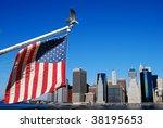 American flag and eagle with Manahttan skyline - stock photo