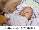 adorable happy baby in pink... | Shutterstock . vector #382087879